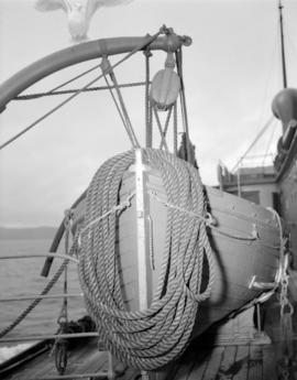 Rope on stern of [lifeboat on ship at] Pacific Mills [on the] Queen Charlotte Islands