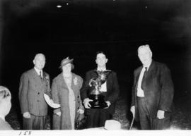 V.E.A. General Manager S.C. McLennan presenting prize to Mr. and Mrs. Wallace of Milford, Langley...