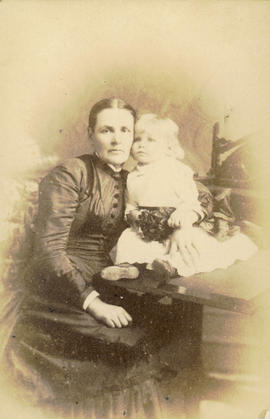 [Studio portrait of woman and child]