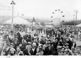 Crowd in midway carnival on Vancouver Exhibition grounds