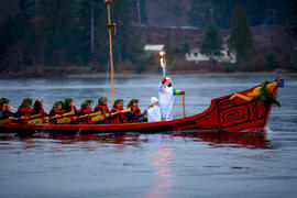 Day 96 Torchbearer 6 Ali Hunt carries the flame on a traditional First Nations canoe in Port Hard...