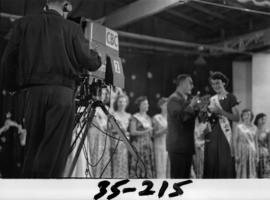 Nancy Hansen on Outdoor Theatre stage being interviewed after being named Miss P.N.E. 1954