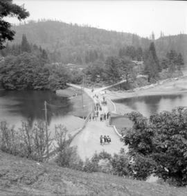 [View from above of people walking along seawall at Bowen Island]