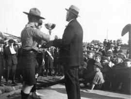[Dr. Robertson presents a trophy at a Boy Scout rally at Hastings Park]