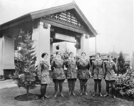 [Gasoline attendants in front of the Imperial Oil Company Limited station on the southeast corner...
