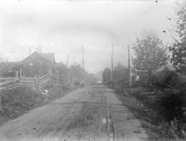 [View of dirt road and schoolhouse, Gibson's Landing]