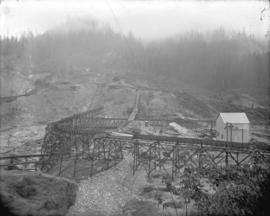 [Partially constructed Coquitlam Dam, showing trestle supported flume]
