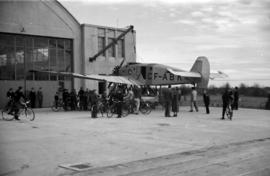 [A CF-ABK airplane outside a hangar]