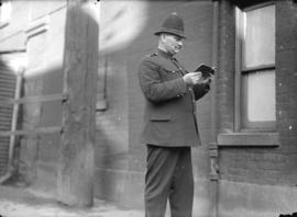 [Police constable standing in Market Lane near City Hall]
