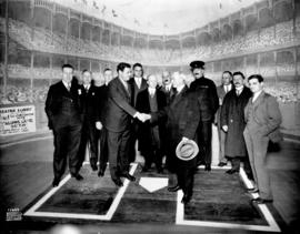 [Babe Ruth shakes hand with L.D. Taylor on the stage of Pantages Theatre]