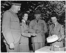 Colonel T.S. Leslie and fellow officers, with cake