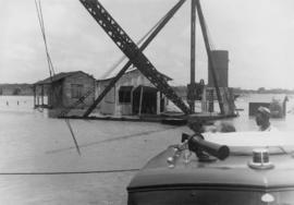 Motorboat and stiff leg derrick - looking west from northwest corner of old sugar warehouse [floo...