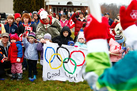 New Day 27 Group of children cheer on the flame in New Brunswick.