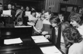 Group around piano at Griffiths Gibson Productions