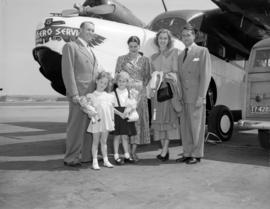 [Portrait of a family in front of an airplane]