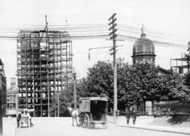 Dominion Bank building [207 West Hastings Street] under contruction, showing old Court House Dome