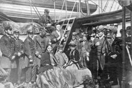 "Group [portrait] of [men and women on board the] ""Chanticleer"""