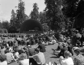 [Audience seated on grass at Malkin Bowl for a concert]