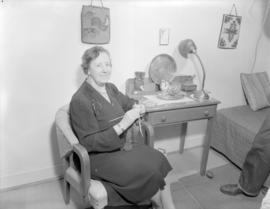 Mrs. A.W. Campbell Matron No. 6 [knitting at] Pacific Mills