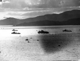 [View of escort ships and pleasure boats passing through Burrard Inlet]
