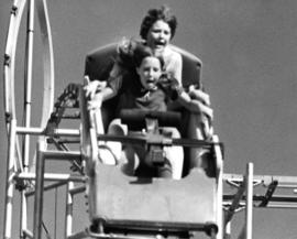 Children on Mad Mouse rollercoaster in P.N.E. Playland