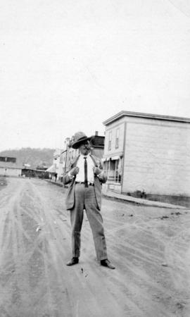 [L.D. Taylor standing on a street]