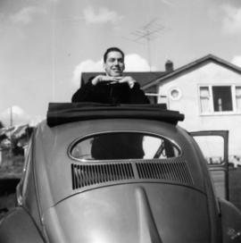 Unidentified man in convertible automobile