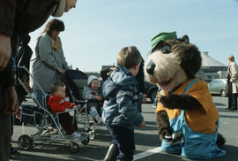Tillicum greeting children in parking lot at Vanier Park