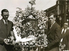 [Two men carrying a wreath for Yip Sang funeral]