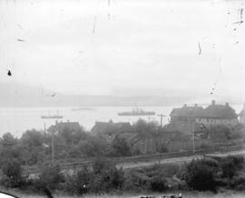 [View of Pender Street between Burrard and Thurlow Streets, showing houses and ships in harbour]