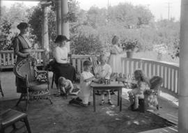 Group at Mr. Arnold's home - West Point Grey [children playing on porch]