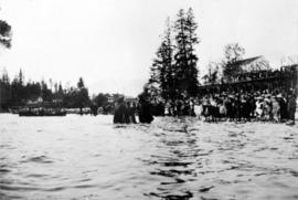 [Woman being baptized by the Reverends Christmas and Fair in English Bay]