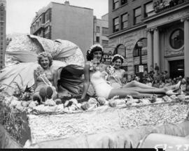Beauty contestants on flower-themed float in 1953 P.N.E. Opening Day Parade