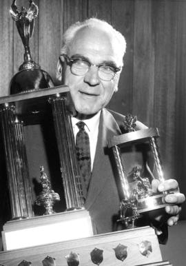 J. Grauer holding trophies