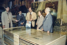 Mike Harcourt, Ferdinand Petrov, unidentified man and Fraser Wilson being interviewed in front of...