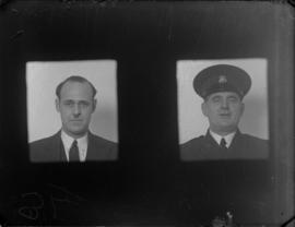 [two unidentified men - police or civic personnel]