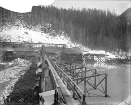 [Partially constructed Coquitlam Dam, looking east along upstream toe of the dam]