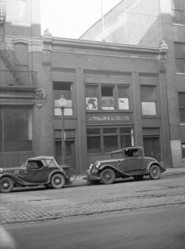 [Cars parked in front of building at 129 Cordova Street]