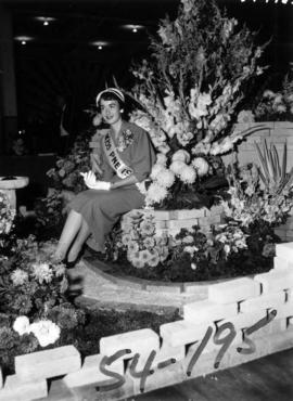 Nancy Hansen, Miss P.N.E., with horticultural display in P.N.E. Forum