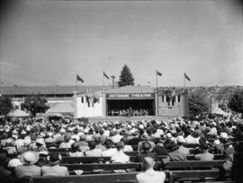 Crowd watching performance on Outdoor Theatre stage