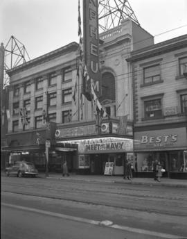 "[Exterior view of the Orpheum Theatre decorated with flags for ""Meet the Navy"" movie pr..."