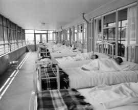 [Children asleep in a dormitory room or hospital ward]