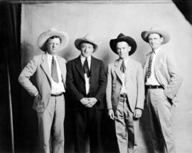 Group photograph of four unidentified men in cowboy hats
