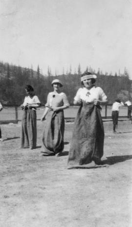 Ladies in sack race at refinery picnic
