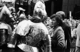 Group of people with actors dressed in knight costumes outside of Castle Vancouver