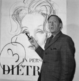Hugh Pickett in front of Marlene Dietrich poster