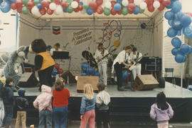 Wolf mascot, Tillicum and band on Chevron Stage during Tillicum's Birthday Party at Playland