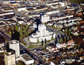 Aerial view of Vancouver City Hall and residential housing, facing northeast, at Cambie Street an...