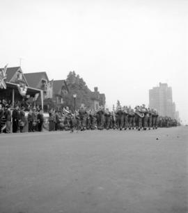 [Military band in a parade along Georgia Street]