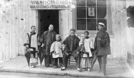 [Wah Chong family outside laundry business on Water Street]